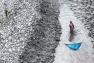 """©Yann Arthus-Bertrand - Femme pêchant au filet sur un bras du delta, sud de Padmapukur, district Khulna, Bangladesh (22° 15' 58,86"""" N – 89° 11' 42,63"""" E)"""